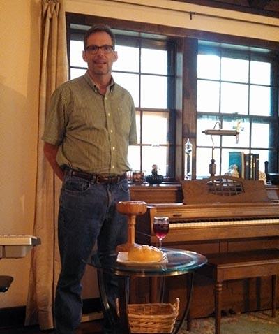 Rev. Kirk Lyman-Barner preparing for worship at Praxis UCC in Americus